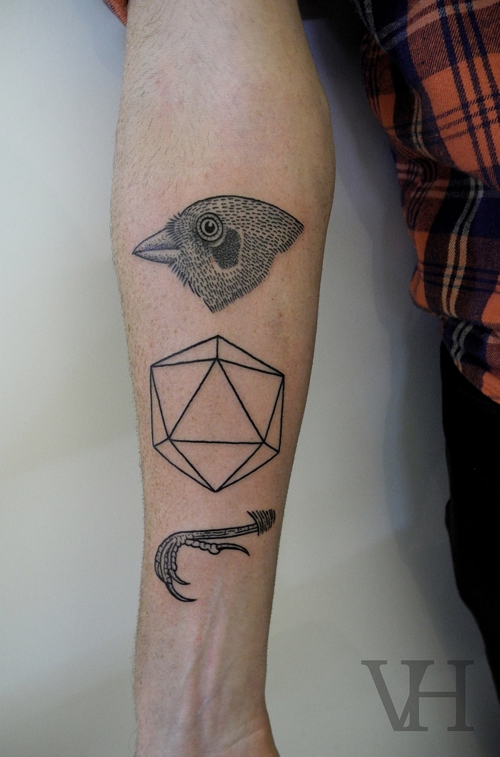 flower of life tattoo, bird head and claws, hexagon in the middle, forearm tattoo, plaid shirt