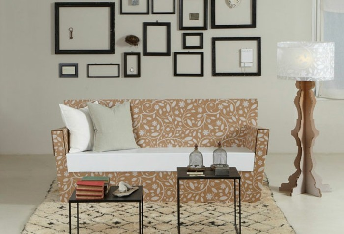 cardboard sofa, with white and grey pillows, cardboard lamp, cardboard furniture, small metal coffee tables