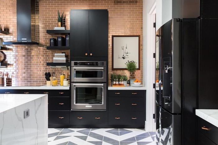 black matte cupboards and drawers, brass tiled wall, marble countertops, kitchen appliances