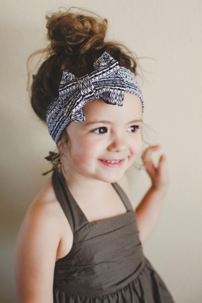 black and white bow bandana, brown hair in a messy bun, easy braid hairstyles, grey background