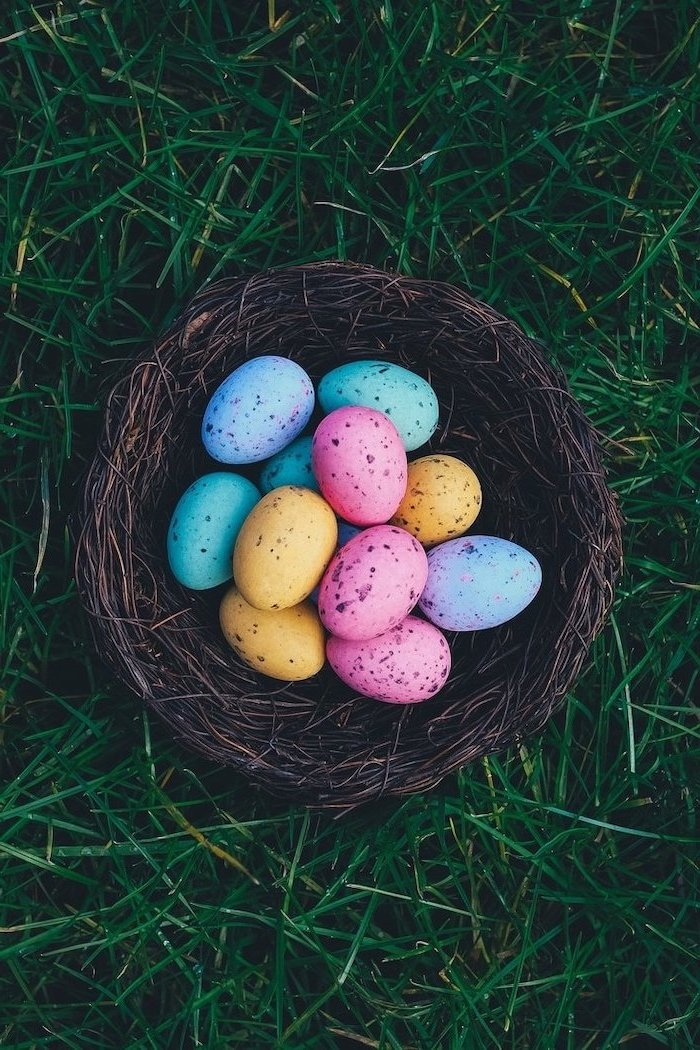 spring images, easter themed phone background, blue pink yellow and purple eggs, in a wooden basket