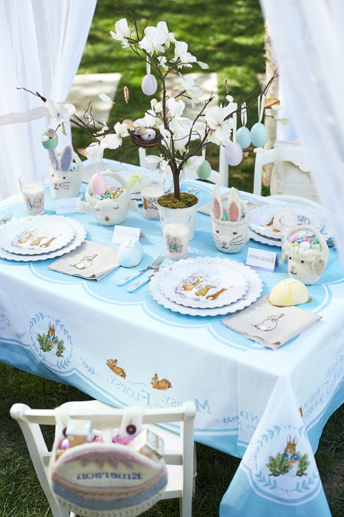ceramic bunny figurines, easter table decorations centerpieces, white plates, kids table setting