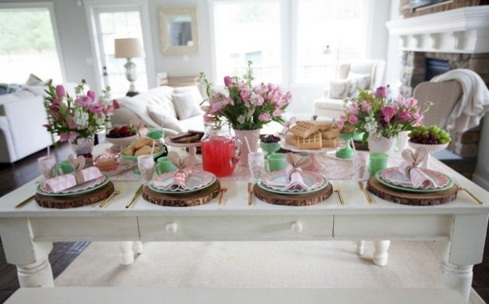 flower bouqets, pink bunny napkins, easter home decor, cake stands, with sweets on them