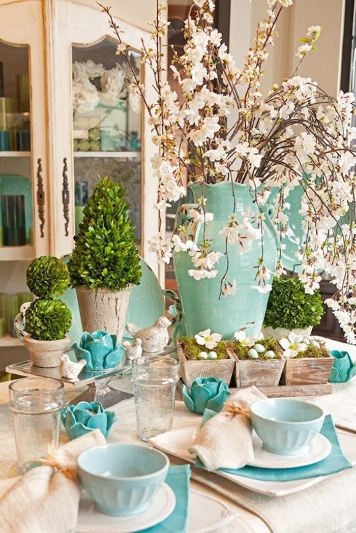 easter home decor, large blue vase, ceramic pots, blue bowls, on a white plate
