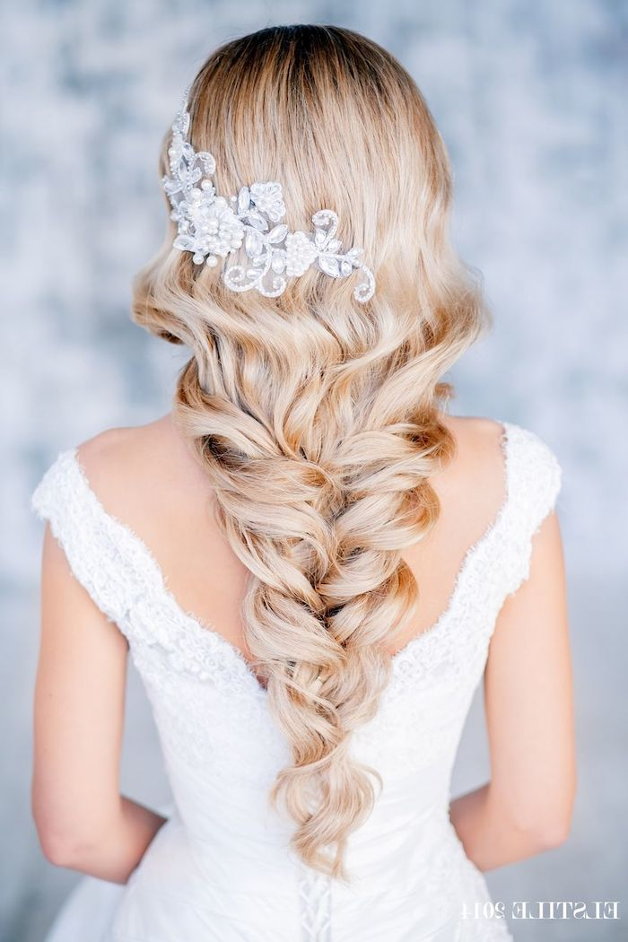 long blonde hair, in a loosely braided ponytail, large hair accessory in hair, wedding hairstyles for long hair