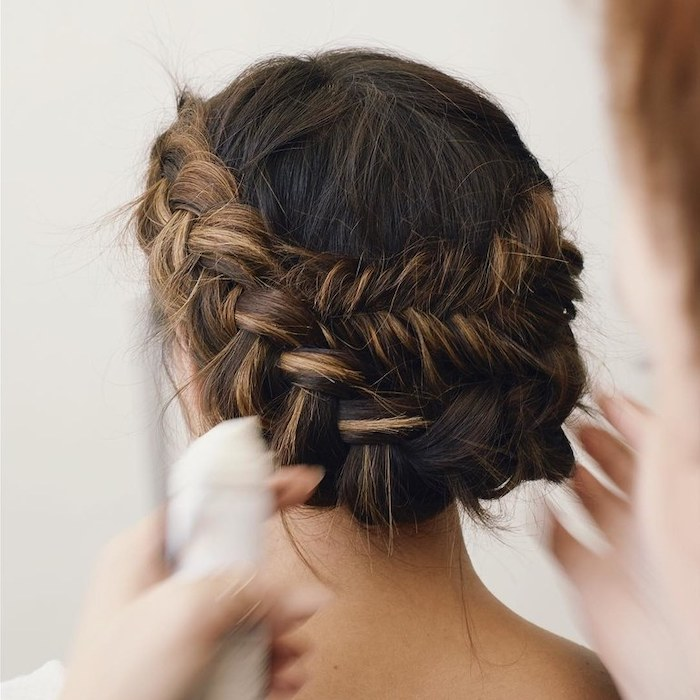 brown hair with highlights, in a braided low updo, wedding hairstyles for long hair, set of hands