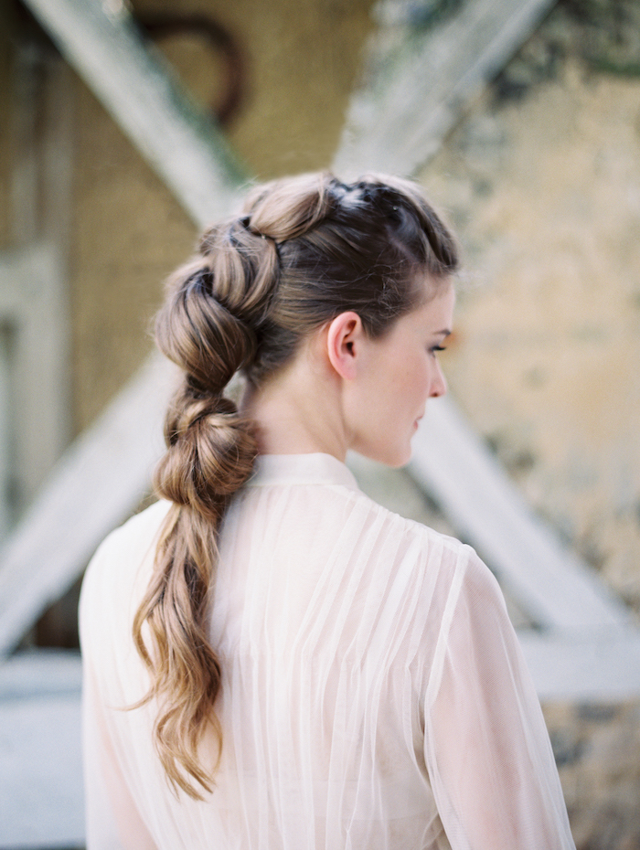 white see through top, long brown hair in a balloon ponytail, wedding hairstyles updo