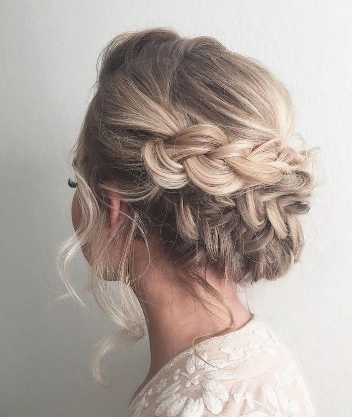 wedding hairstyles updo, blonde hair, braided low updo, white dress, white background