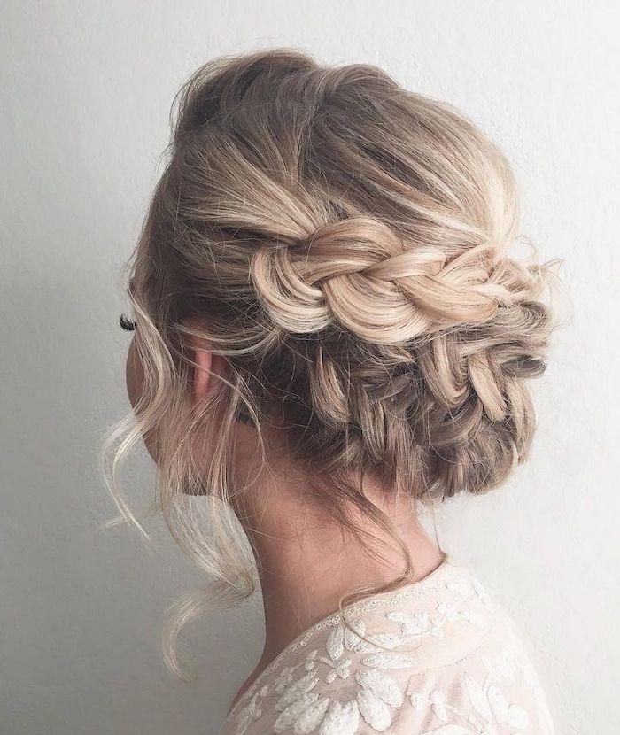 wedding hairstyles updo, blonde hair, braided low updo, white dress, white background