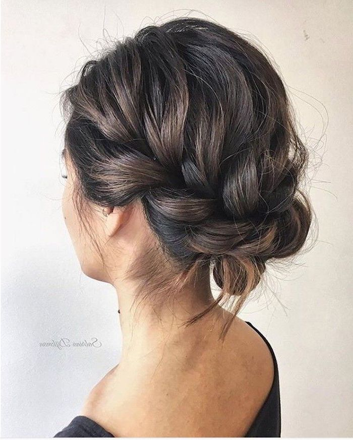 white background, wedding hairstyles updo, brown hair in a braided updo, black top