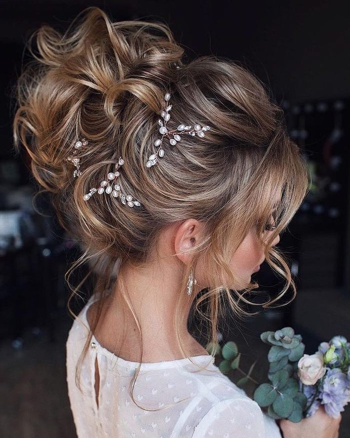 long brown hair with highlights, bridal udos, small pearl accessories, white dress, small flower bouquet
