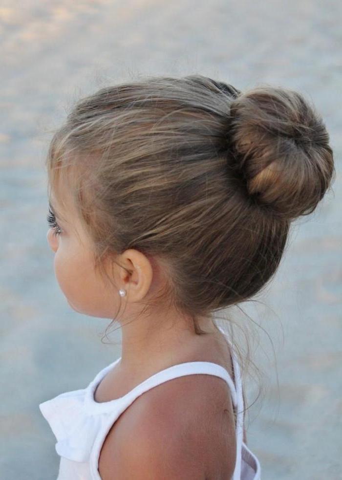 white top, blurred background, short hairstyles for girls, dark blonde hair in a bun