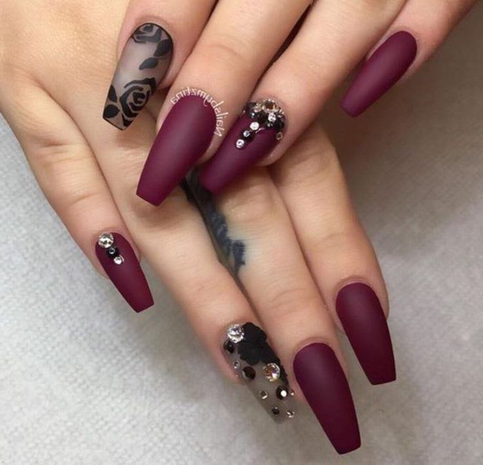 burgundy matte nail polish, simple nail designs, flowers drawn with black matte nail polish, with rhinestones