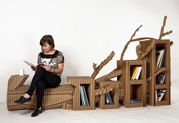 diy cardboard, chair and bookshelves, woman sitting and reading, intricate design, furniture made of cardboard