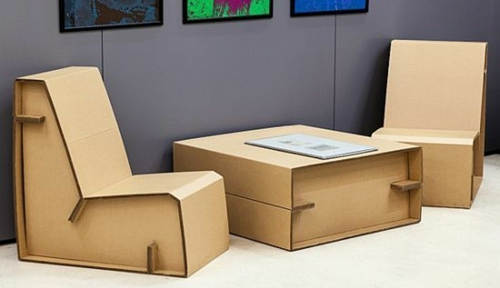 diy cardboard, cardboard armchairs and table, purple wall, framed paintings, white floor