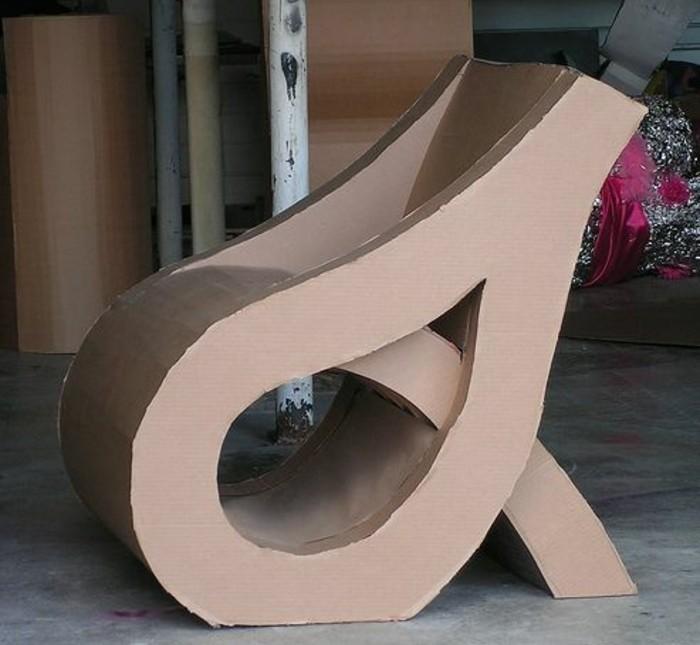grey cement floor, cardboard chair, intricate design, cardboard dresser