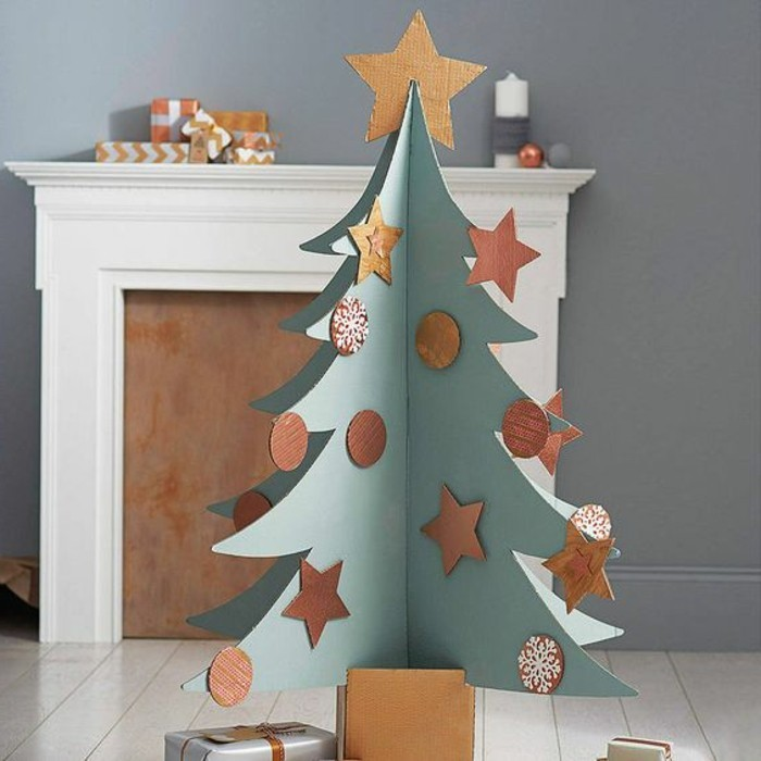 white tiled floor, cardboard shelves, cardboard christmas tree, with ornaments and a star