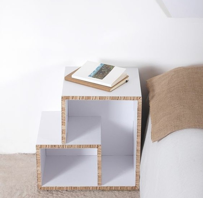 cardboard night stand, painted in white, in front of a white wall, how to make cardboard