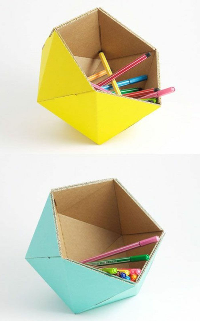 cardboard table, cardboard pencil holders, painted in yellow and turquoise, full of pens and pencils