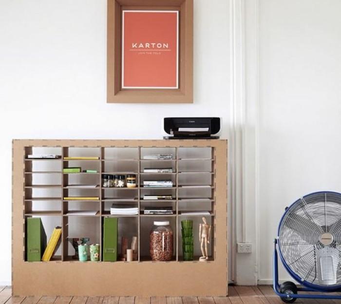 cardboard bookshelf, cardboard table, cardboard photo frame, white wall, large blue fan
