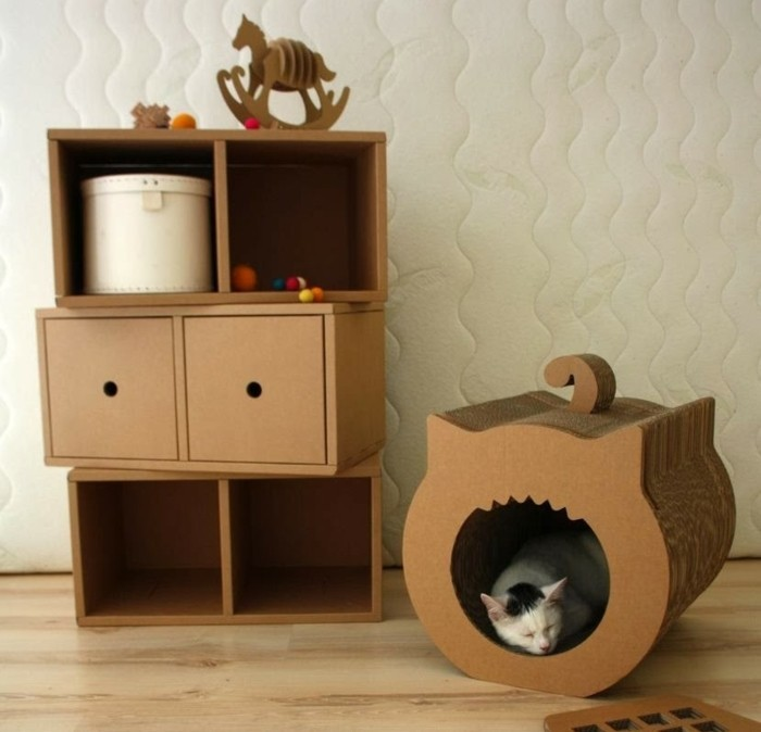 cardboard drawers and shelves, cardboard table, cardboard kitty box, wooden floor, white wall