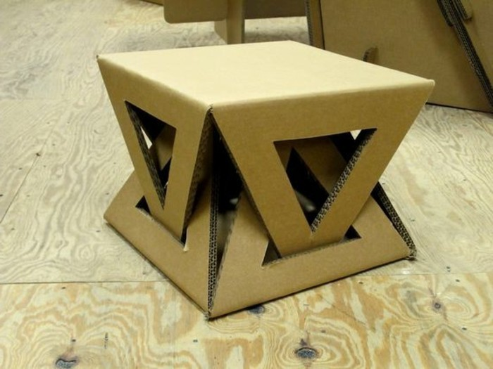 cardboard stool, intricate design, cardboard table, on a wooden floor