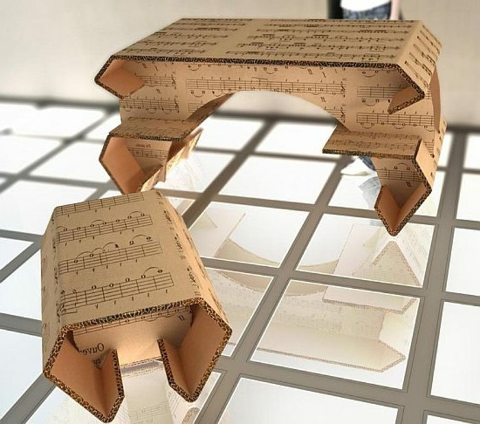 cardboard furniture diy, musical notes printed on the cardboard, cardboard table and stool