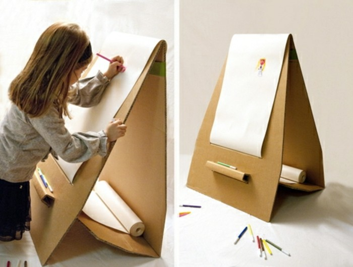 cardboard drawing stand, little girl drawing, cardboard chair design, lots of pencils