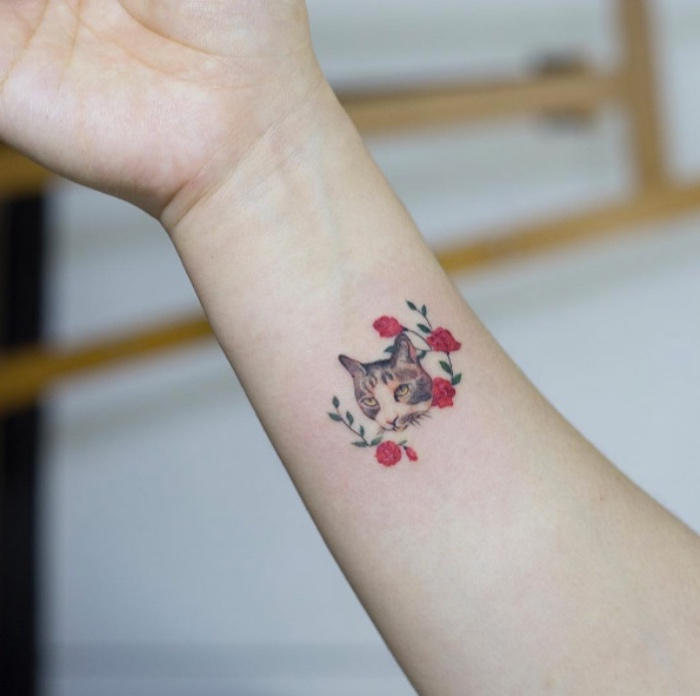 cat and red roses wrist tattoo, small tattoos for women, blurred background
