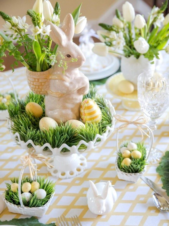 ceramic bunny figurines, bouquets of white flowers, simple table decorations, dyed eggs