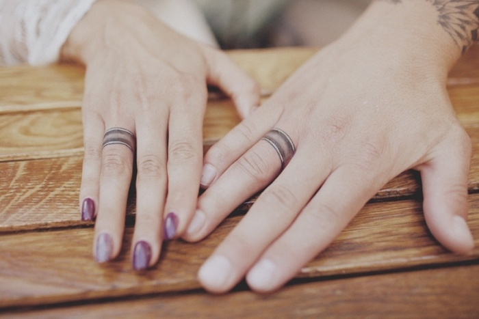 finger tattoos for men, purple nail polish, his and hers rings, ring finger tattoos for couples, hands next to each other