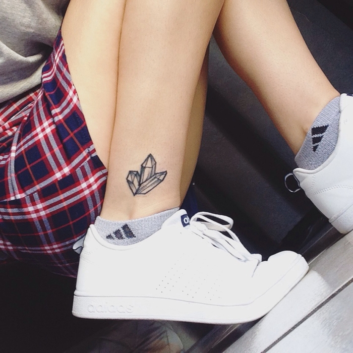 white sneakers, black and white crystals ankle tattoo, sacred geometry tattoo, plaid shirt