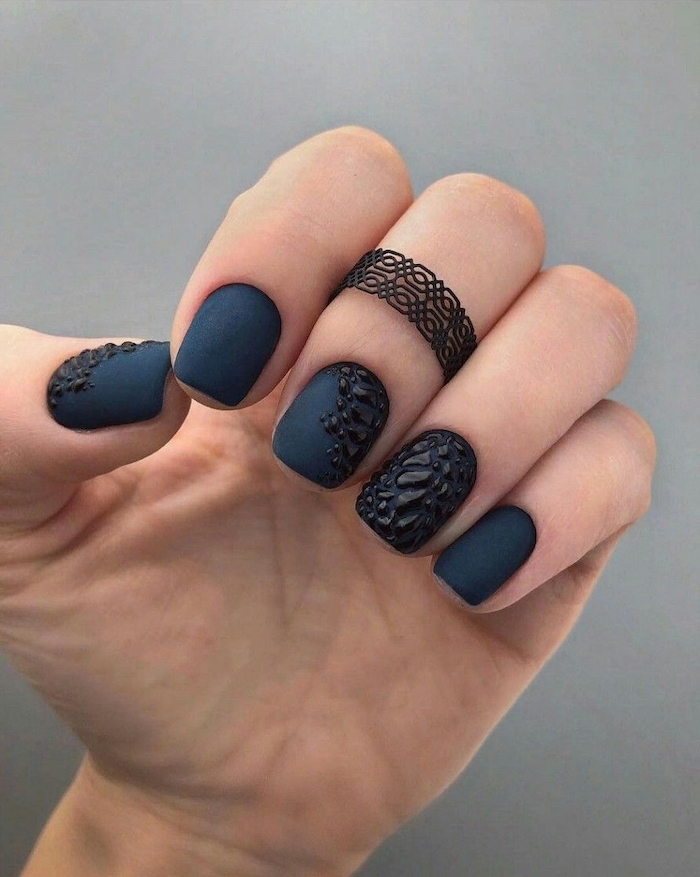 dark blue matte nail polish, d3 manicure design, squoval nails, pink nail designs, black ring on the middle finger
