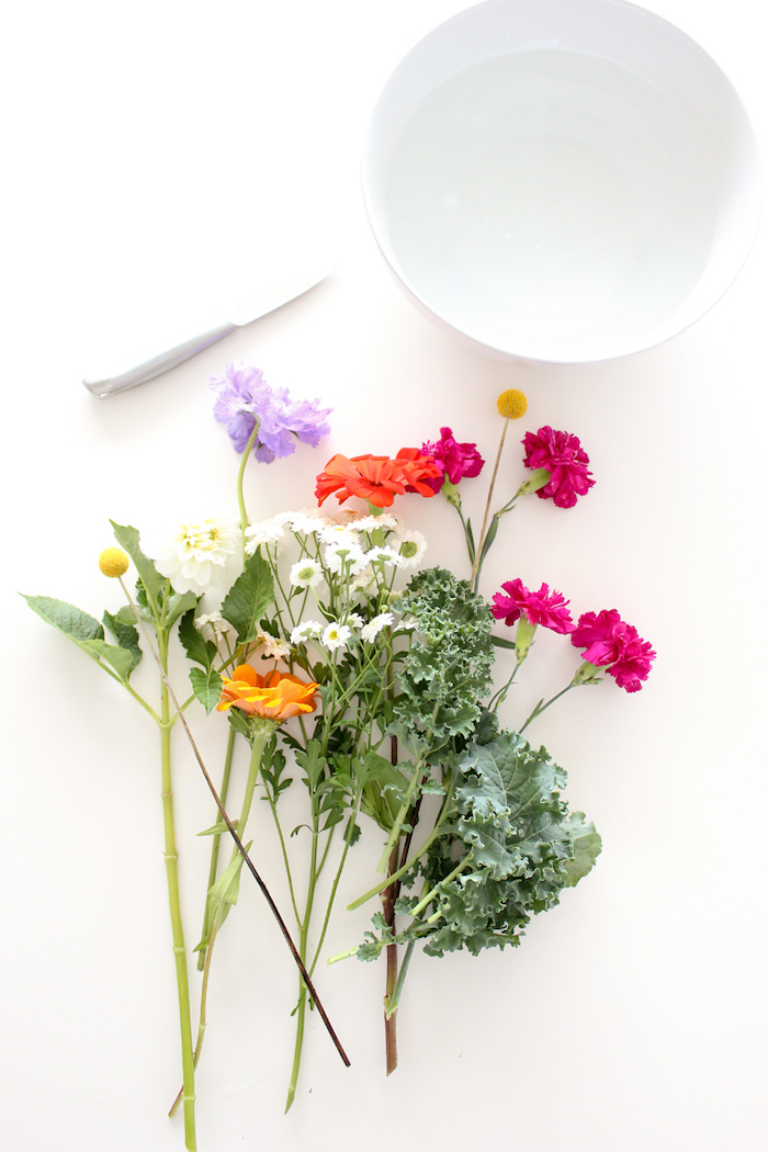 white round vase, colourful flowers and a knife, on a white countertop, flower centerpieces, diy tutorial