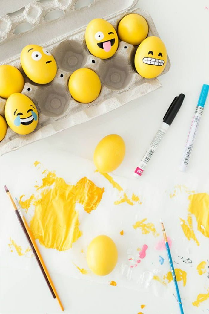 yellow eggs, with faces drawn on them, in an egg carton, yellow paint, how to dye eggs with food coloring