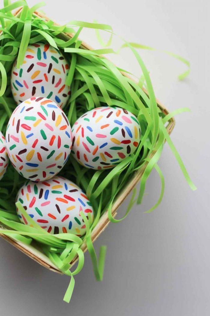 chocolate sprinkles eggs, in a wooden basket, natural egg dye, colourful sprinkles, on white eggs