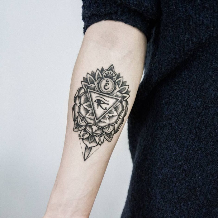 black fluffy sweater, white background, forearm tattoo, inspired by egyptian gods, flower of life tattoo