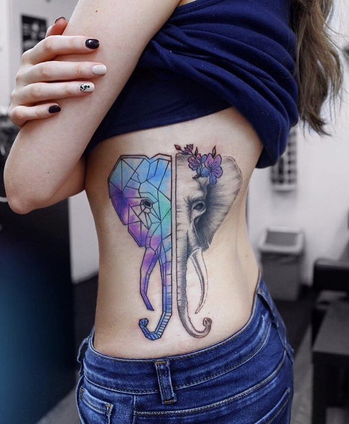 elephant head colourful tattoo, on the side of a girl's stomach, balance tattoo, navy top and jeans