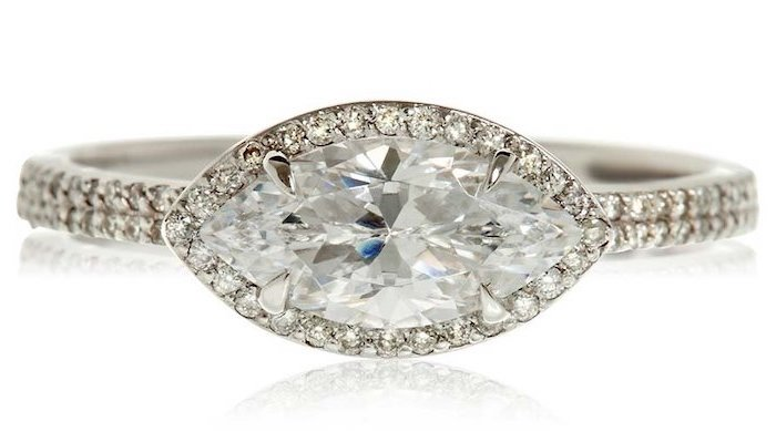 eye shaped diamond surrounded by smaller diamonds, engagement ring styles, white background