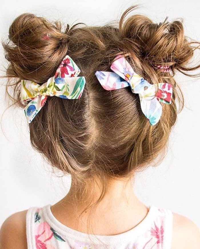 floral bows, two messy buns, brown hair, floral top, cute hairstyles for girls, white background
