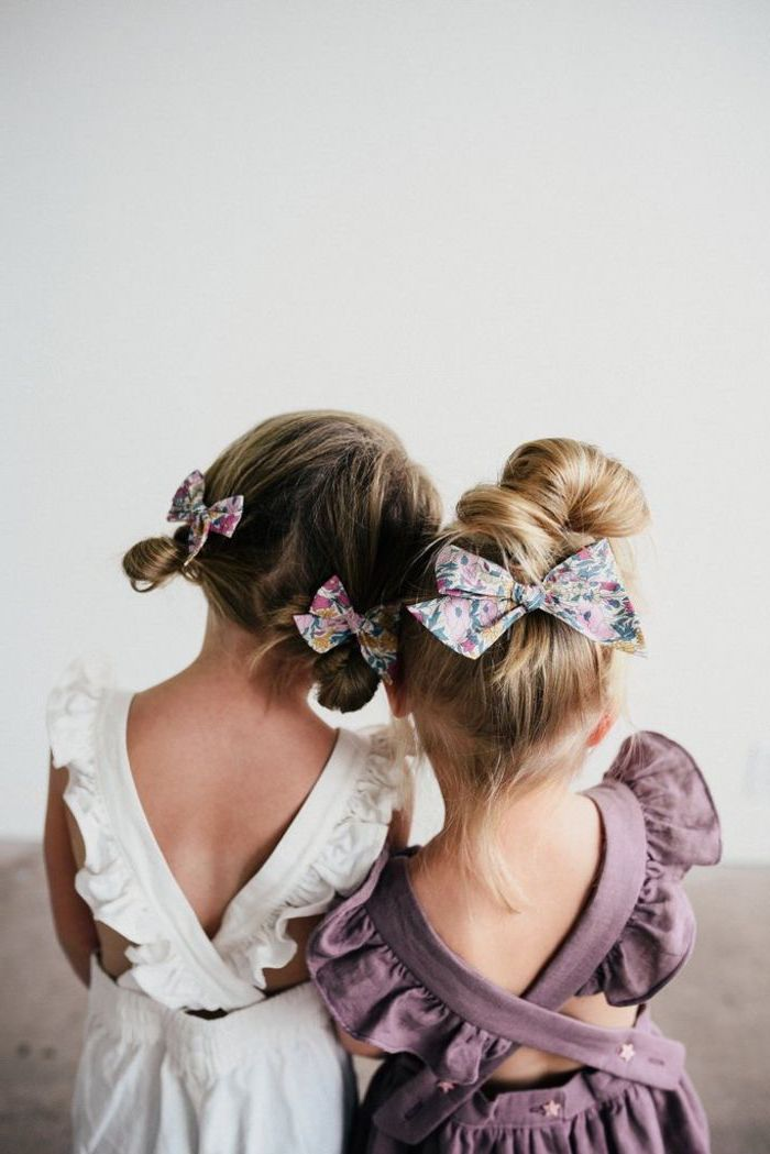 little girl hairstyles, floral bows, messy buns, made on blonde and brown hair, white and purple dresses