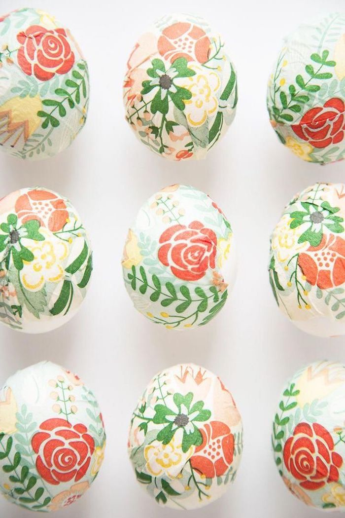 floral decoupage eggs, colourful eggs, on a white background, natural egg dye