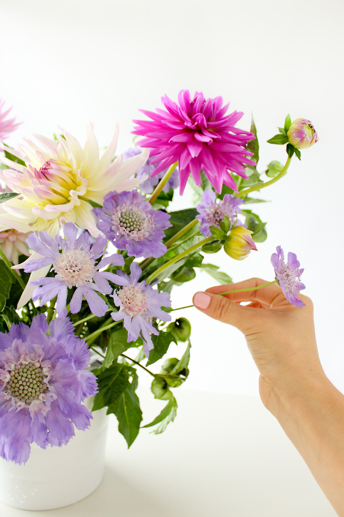 diy tutorial, flower centerpieces, colourful flower bouquet, in a white vase, in front of a white background