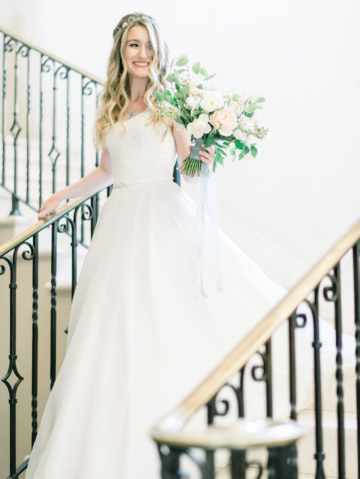 long white dress, easy hairstyles to do yourself, large flower bouquet, long wavy blonde hair, large staircase