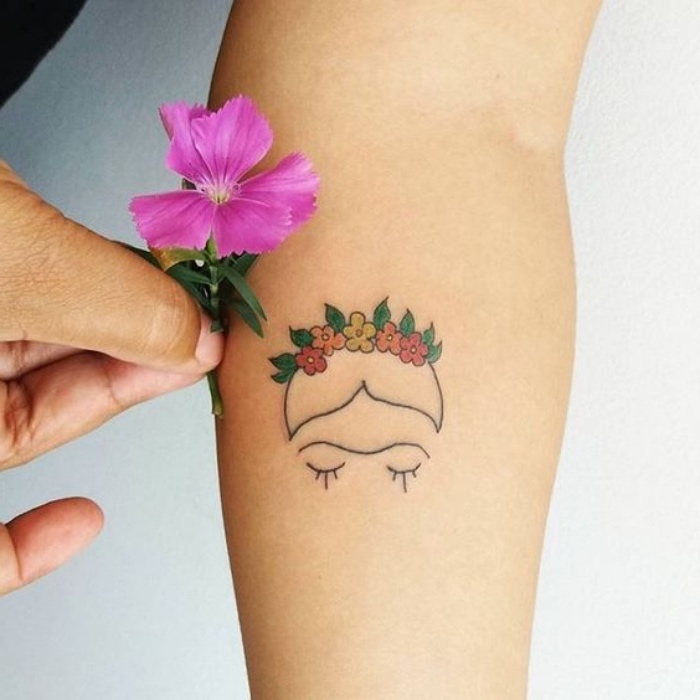 woman holding a flower, face and flower crown forearm tattoo, small tattoo, white background