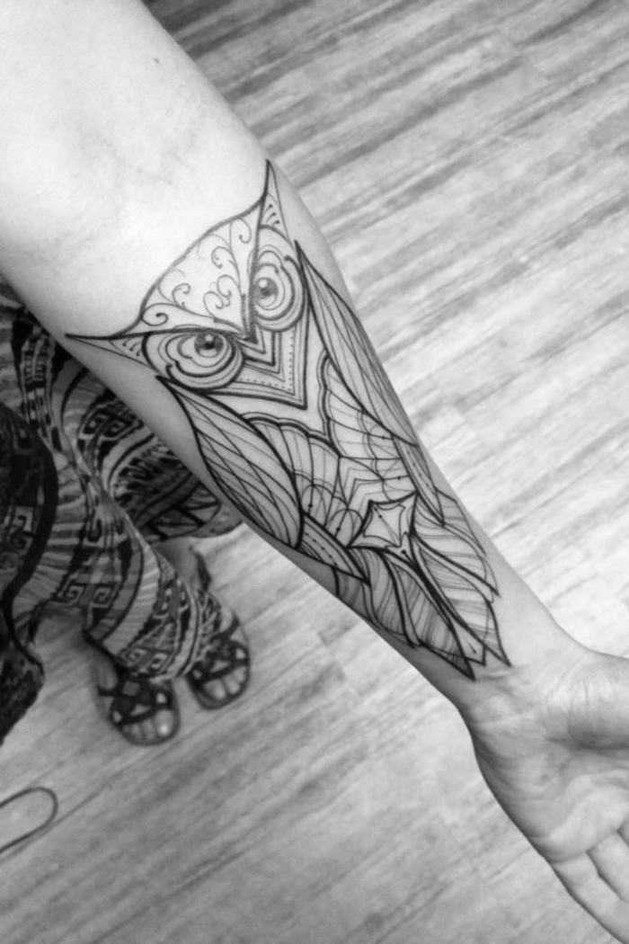 balance tattoo, large geometrical owl, tattooed on the forearm, girl with skirt and sandals