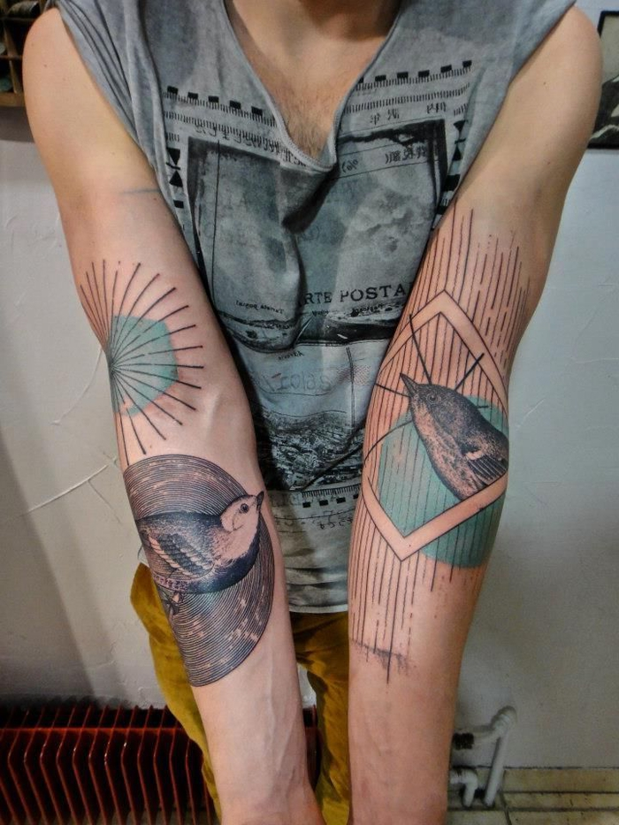 tattoos on both arms, flying birds, surrounded by geometrical shapes, geometric tattoos