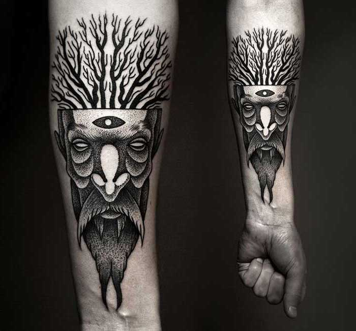 pagan god of the forest, forearm tattoo, black and white, black background, tattoo ideas for men, hand in a fist