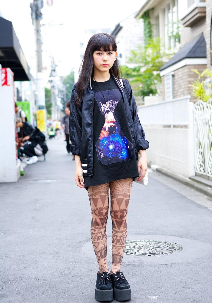 geometrical whole legs tattoo, girl wearing black dress and jacket, back forearm tattoos