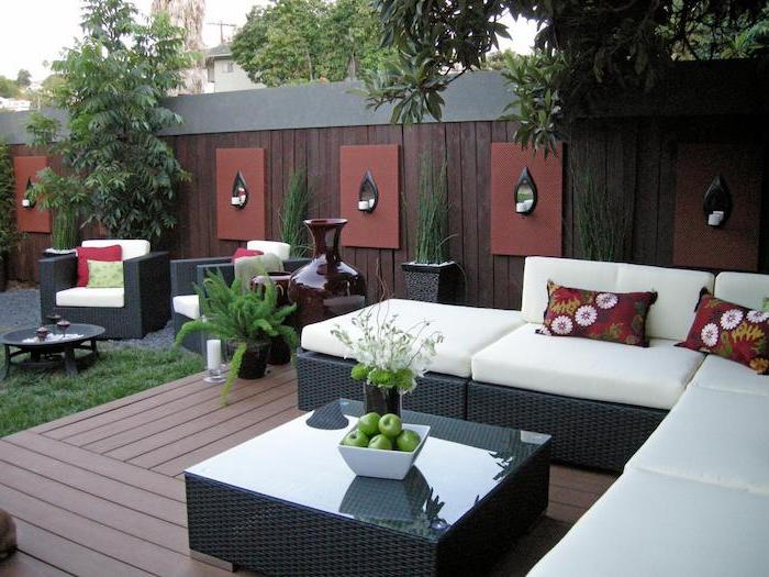 garden furniture, with colourful throw pillows, small backyard landscaping ideas, on a wooden floor